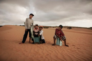 A group of child workers at the red sand dunes outside Mui Ne, Vietnam.