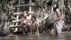 A family bathes in a river in Southwest Thailand.