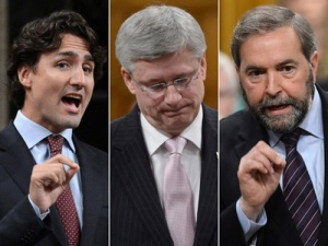 OTTAWA - May 30, 2013 - (L-R) Liberal leader Justin Trudeau, prime minister Stephen Harper and NDP leader Tom Mulcair debate each other in the House of Commons during the week of May 27, 2013. For 0531-col-Den-Tandt ORG XMIT: POS1305301530472063